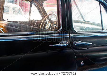 Part Of  Old Black Car