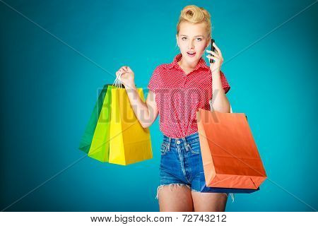 Pinup Girl With Shopping Bags Calling On Phone