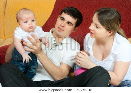 Happy Family - Mother, Father And Baby