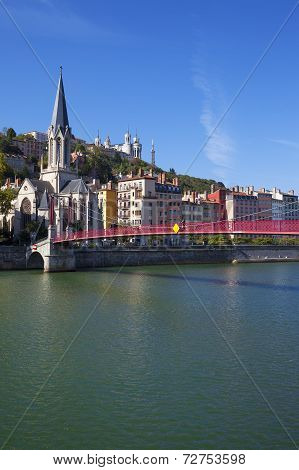 View Of Lyon City With Red Footbridge