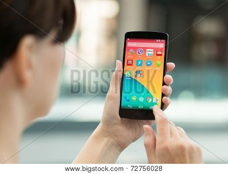 Woman Holding Google Nexus 5