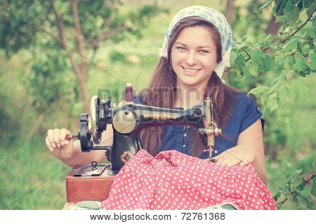 Seamstress woman with vintage sewing machine