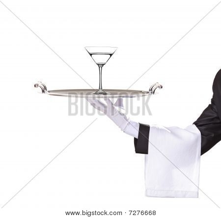 A butler holding a tray with cocktail on it