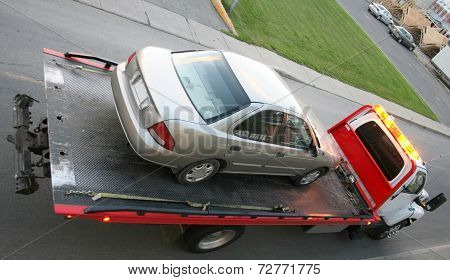 Car on a flatbed truck
