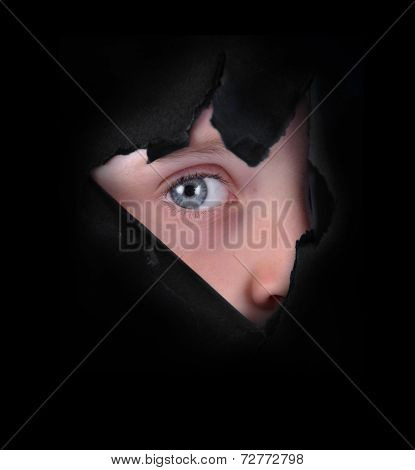 Child Peeking Through Black Paper