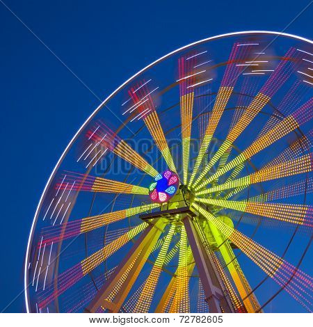Ferris Wheel Carousel On A Dark Blue Sky Background.