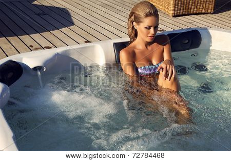 Sexy Woman With Blond Hair In Bikini Relaxing In Outdoor Whirlpool