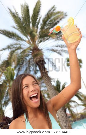 Happy Woman With Drink At Tropical Resort Toasting