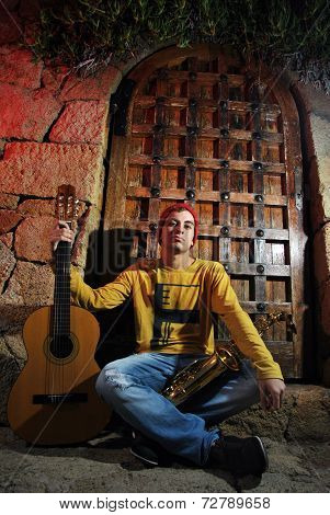 Modern Musician Posing With His Guitar