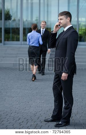 A Businessman Talking By The Cellphone