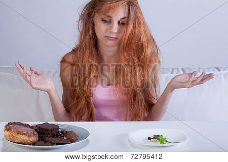 Girl Trying To Overcome Hunger For Sweets