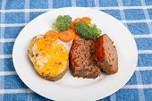stock photo of meatloaf  - Fresh sliced meatloaf with twice baked potato and broccoli and carrots - JPG