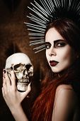 foto of gothic female  - Portrait of a beautiful gothic girl holding the skull - JPG