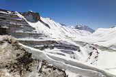 pic of open-pit mine  - Open Pit Copper Mine in Chile covered by snow - JPG