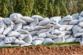 foto of sandbag  - Sandbags for flood defense or military use - JPG