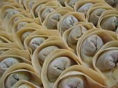 stock photo of wanton  - Homemade chinese dumpling or wanton ready to be cooked and eaten - JPG