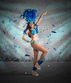 stock photo of samba  - Happy samba dancer with brilliant blue costume - JPG