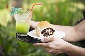 stock photo of baking soda  - Bread with raisins and Kiwi juice soda on the tray - JPG