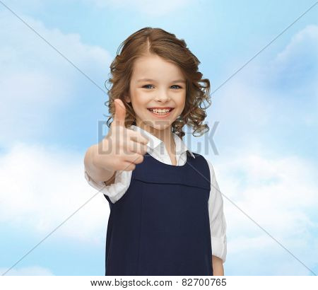 people, gesture, children, summer vacation and happiness concept happy little school girl showing thumbs up blue sky background