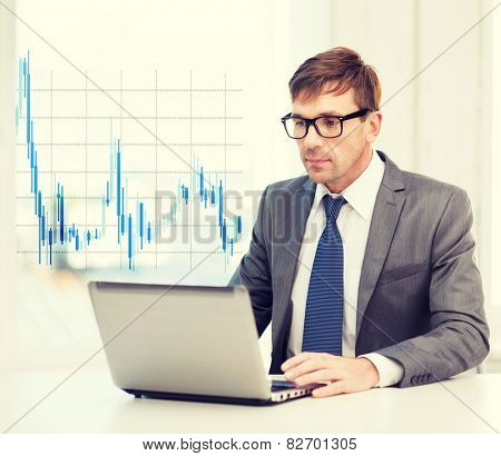 technology, money, business and office concept - handsome businessman in black eyeglasses with laptop computer and forex chart