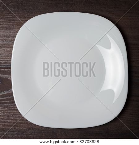 white square plate on wooden brown table