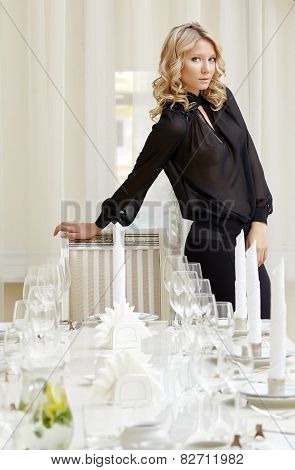 Elegant blonde posing in posh restaurant