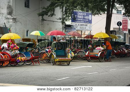 Malaysia, Penang, Georgetown - Circa Jul 2014: Cycle Rickshaws Or Pedicabs Lined Up And Waiting For