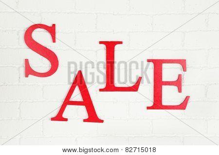 Sale on brick wall background