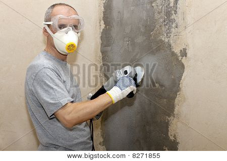 man in respirator and spectacles