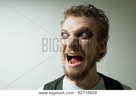 portrait of evil, aggressive man with makeup