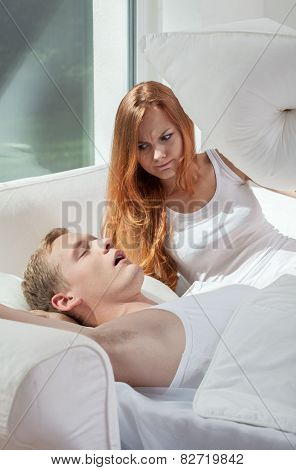 Snoring Man And His Wife