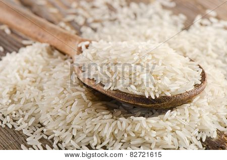 Uncooked Rice In Wooden  Spoon