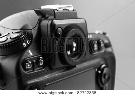 Digital camera on gray background
