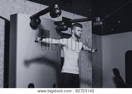 Male Athlete Doing Heavy Weight Exercise For Shoulders