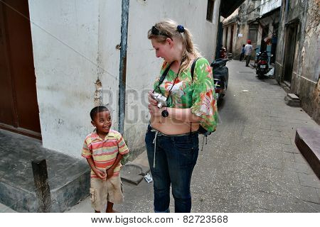 Black Child Local Resident Island Of Zanzibar Communicates With Tourist