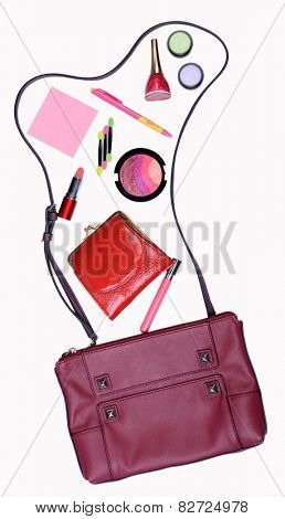 Ladies handbag and things with accessories of it isolated on white