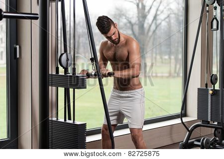 Male Athlete Doing Heavy Weight Exercise For Triceps