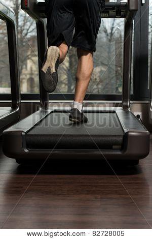 Fitness Man Running On Treadmill