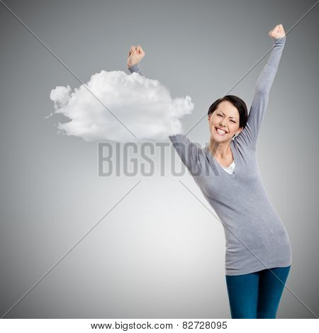 Beautiful girl gesturing triumphal fists, isolated on grey background with cloud