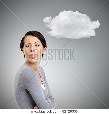Young pretty woman sticks out tongue,  grey background