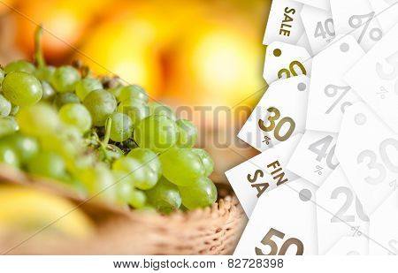 Close up view of grape and oranges on sale in the braided basket. Concept of healthy food