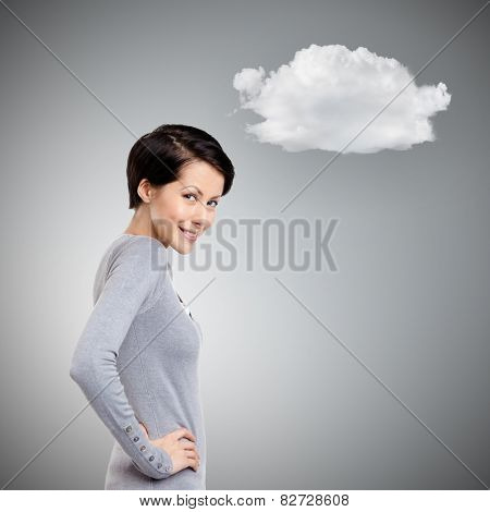 Mysterious young woman with cloud, on grey