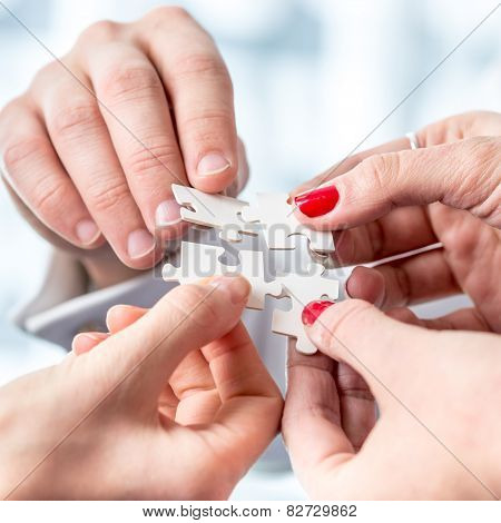 Human Hands Assembling Puzzle Pieces