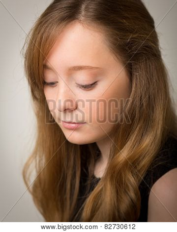 Ginger Teenage Girl Looking Down