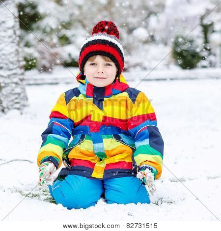 Funny Preschool Boy In Colorful Clothes Happy About Snow, Outdoors