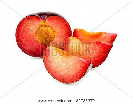 Juicy Vibrant Tasty Fresh Plum With Slices Isolated On White