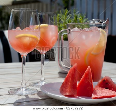Fruit Lemonade: Two Glasses, Pitcher, Watermelon Slices On The Wooden Table.