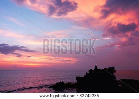 sunset over hindu temple Tanah Lot, Bali, Indonesia