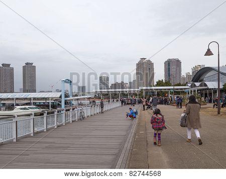 People Walk Along The Promenade
