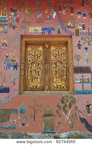Beautiful mosaic and gold painted window at Xieng Thong temple in Luang Prabang, Laos.